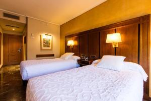 Cama o camas de una habitación en Hotel Condestable Iranzo