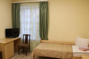 Кровать или кровати в номере «Звенигородская»