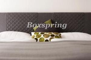 Ein Bett oder Betten in einem Zimmer der Unterkunft Ferien am Kurpark