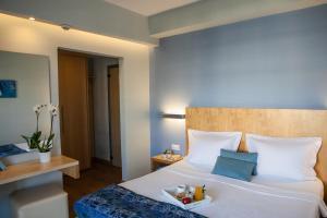 Ένα ή περισσότερα κρεβάτια σε δωμάτιο στο Ξενοδοχείο Κρόνος