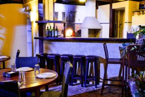 A restaurant or other place to eat at Estalagem Casa Grande Pousada