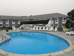 The swimming pool at or close to Ambassador Inn and Suites