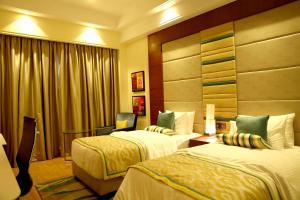 A bed or beds in a room at The P L Palace Agra