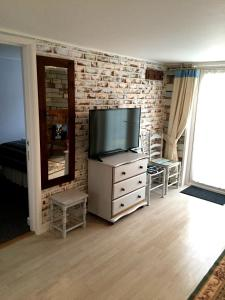 A television and/or entertainment center at Lark Rise B&B