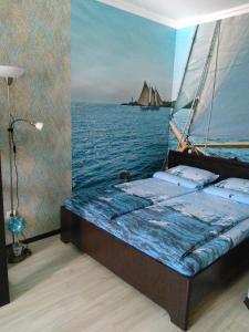Кровать или кровати в номере ЖК Панорама Стадион Краснодар