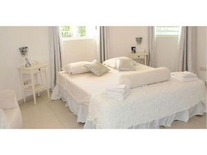 A bed or beds in a room at Champartments Resort - Villa & Appartementen Dom Perignon