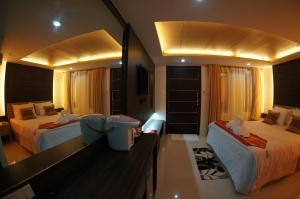 A bed or beds in a room at TT Naiyang Beach Phuket