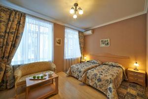 Кровать или кровати в номере Парк-Отель Шереметьевский