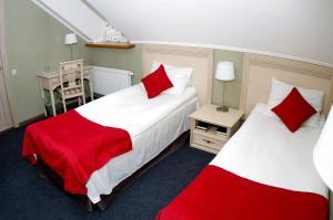 Кровать или кровати в номере Гостевой дом «Гончаровъ»