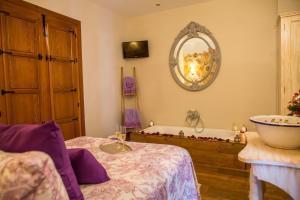Cama o camas de una habitación en Hotel Rural Sisapo