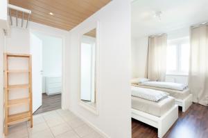 Ein Bett oder Betten in einem Zimmer der Unterkunft GreatStay Apartment - Stralauer Allee