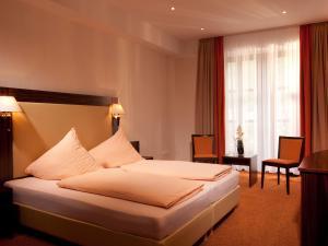Een bed of bedden in een kamer bij Beim Weinbauer