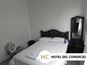 Кровать или кровати в номере Hotel del Comercio