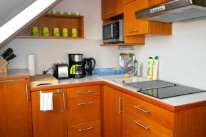 A kitchen or kitchenette at Azúr-Ház Sky Terrace Appartement