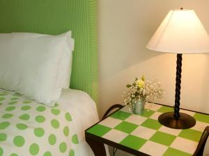A bed or beds in a room at Quinta Miraflores Boutique Hotel