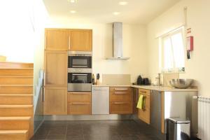 A kitchen or kitchenette at Casa Baxri
