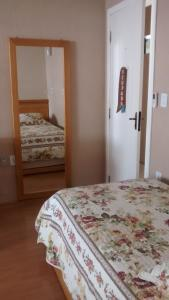 Cama ou camas em um quarto em Estrelatto Residence
