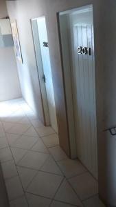 Um banheiro em Estrelatto Residence