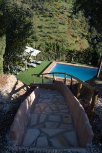 Poolen vid eller i närheten av Rural Montes Málaga: Finca Pedregales