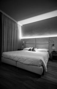 Letto o letti in una camera di Hotel Everest