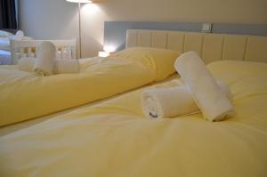 Ein Bett oder Betten in einem Zimmer der Unterkunft Hotel Jeta