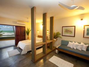 Cama ou camas em um quarto em Pousada Taipu de Fora