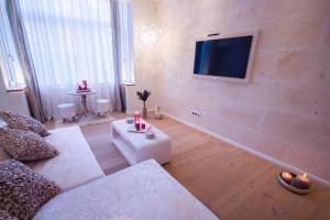 A television and/or entertainment center at Design Suites Palma