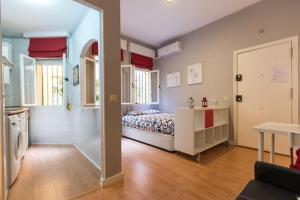 Cama o camas de una habitación en Loft Basilica Macarena