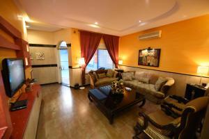 Uma área de estar em Wakan Luxury Villas and Suites