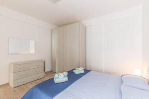 Letto o letti in una camera di Casa Vacanze Sole e Sabbia