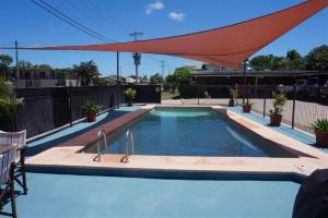 The swimming pool at or near A & A Motel