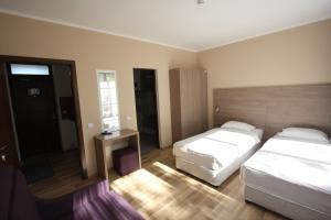 Кровать или кровати в номере Studio ApartCity