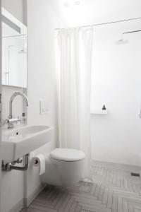 Salle de bains dans l'établissement Terra Maria Hotel