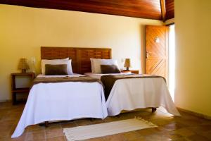 A bed or beds in a room at Pousada Berro do Jeguy