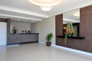 The lobby or reception area at Alano Executivo Hotel