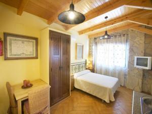 Cama o camas de una habitación en Apartamentos Rurales La Platea