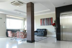 A seating area at Alano Executivo Hotel