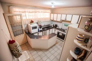 A kitchen or kitchenette at Casa Flor de Lis