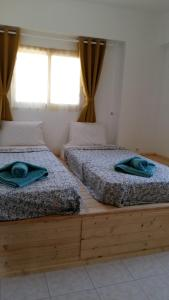 A bed or beds in a room at CrossRhodes Plakia Beach