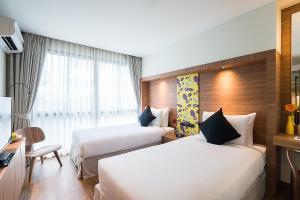 Кровать или кровати в номере Sunshine Hip Hotel