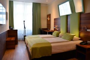 A bed or beds in a room at Arthotel Munich