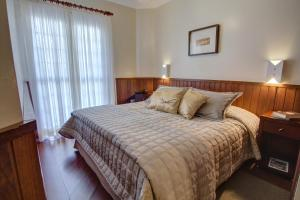 Uma cama ou camas num quarto em Hotel Palazzo Reale