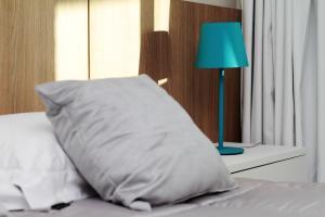 Cama ou camas em um quarto em Flat Ocean View III