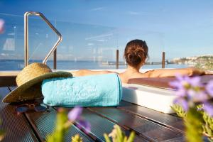 The swimming pool at or close to Hotel Porto Santa Maria - PortoBay - Adults Only