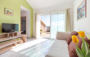 Postel nebo postele na pokoji v ubytování Apartments Kike