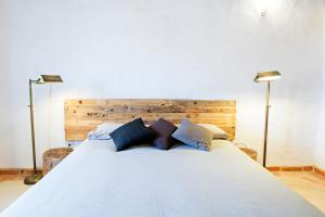 A bed or beds in a room at Quinta do Arade