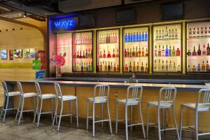 The lounge or bar area at Aloft Montreal Airport