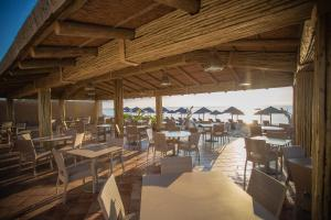 A restaurant or other place to eat at Village Vacances La Vallicella