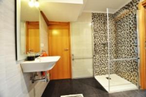 Un baño de Orio Apartments