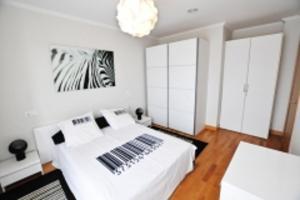 Cama o camas de una habitación en Orio Apartments